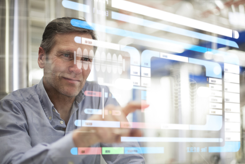 Man using transparent touchscreen device